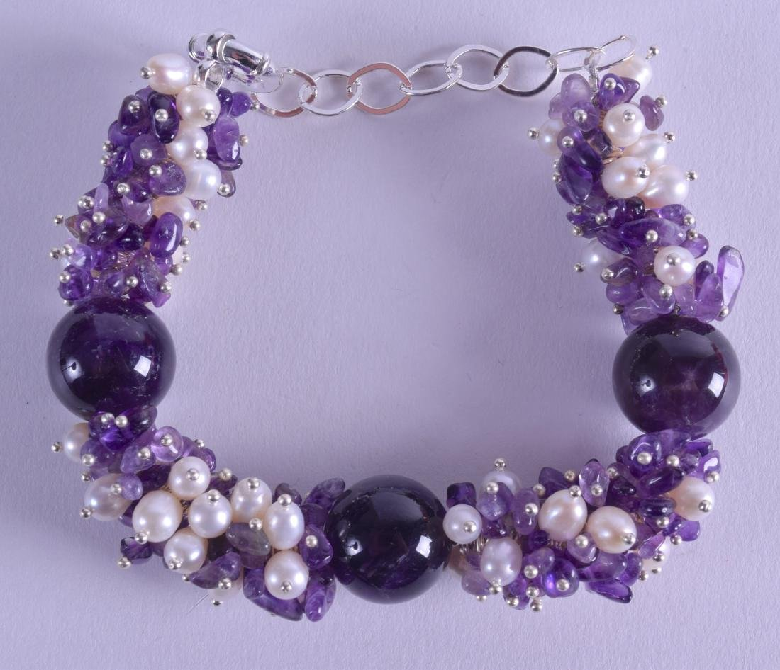 A SILVER PEARL AND AMETHYST BRACELET.