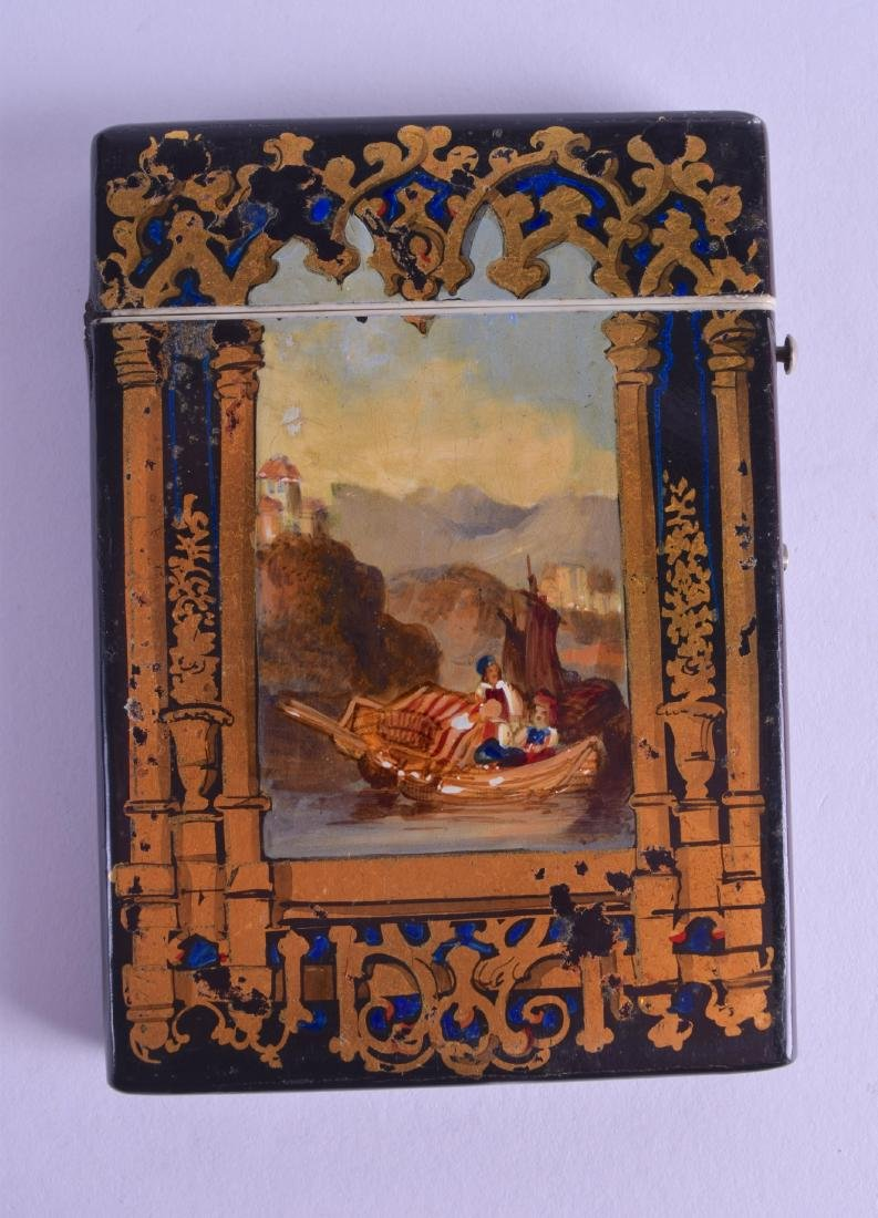 A VICTORIAN PAPIER MACHE CARD CASE painted with figures