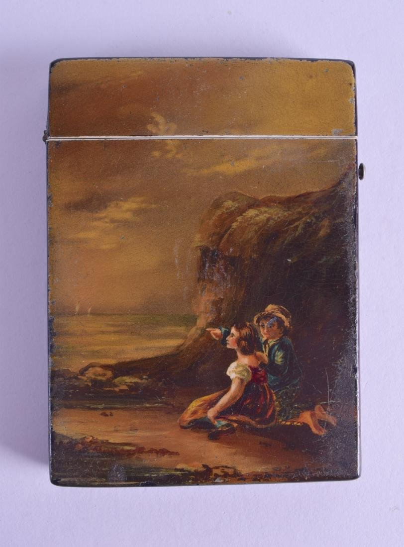 A VICTORIAN PAPIER MACHE CARD CASE painted with two