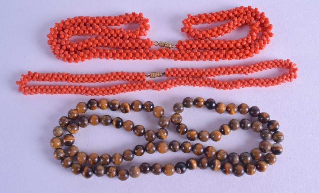 TWO EARLY 20TH CENTURY CORAL NECKLACES together with a