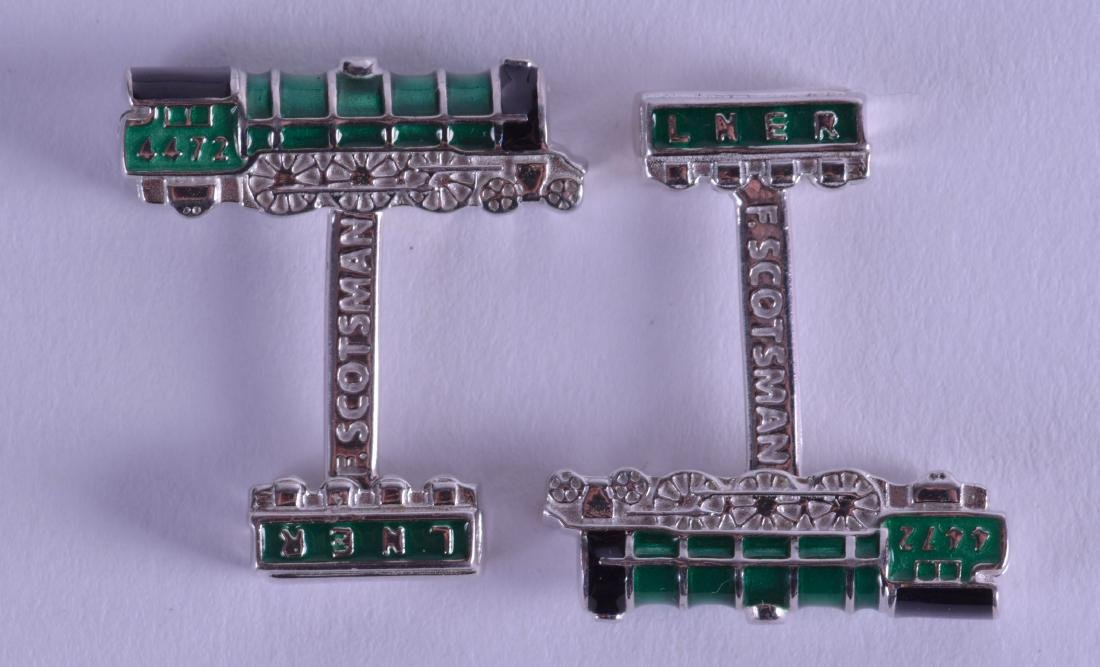 A PAIR OF SILVER AND ENAMEL LNER 4472 RAILWAY