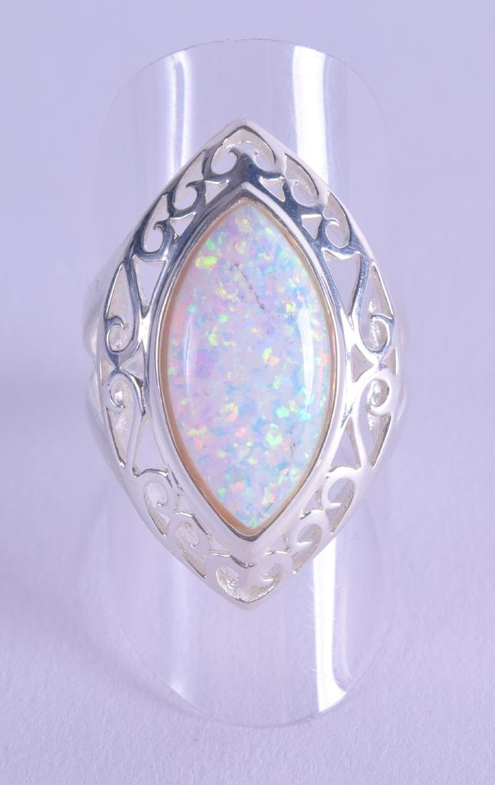 A SILVER AND OPAL RING.