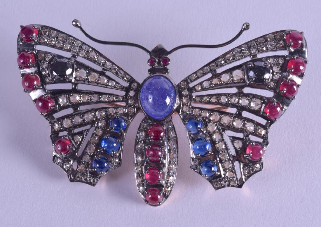 A GOLD SILVER RUBY AND GEM STONE DIAMOND BUTTERFLY