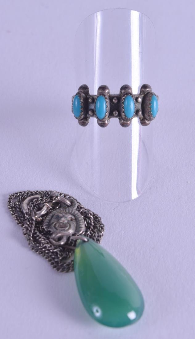 AN ANTIQUE SILVER AND TURQUOISE RING together with a
