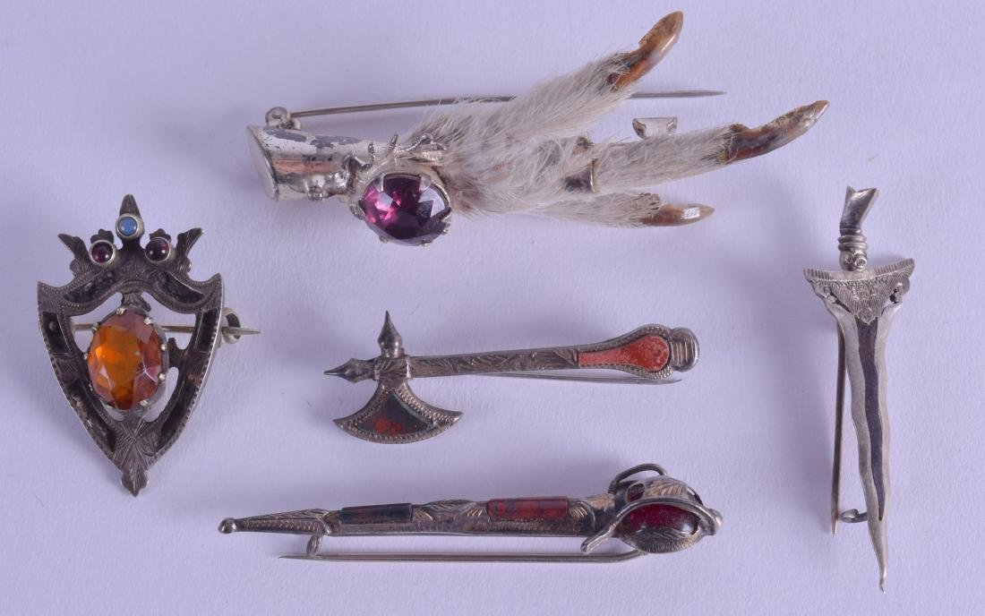 A COLLECTION OF FIVE ANTIQUE SILVER BROOCHES including