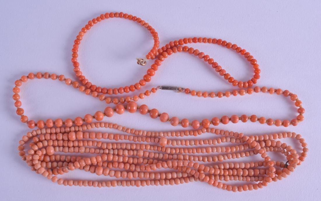 A GROUP OF THREE EARLY 20TH CENTURY RED CORAL NECKLACES