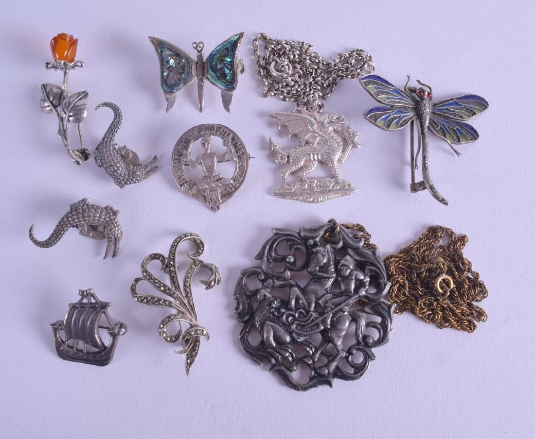 AN UNUSUAL EARLY 20TH CENTURY SILVER AND AMBER FLOWER
