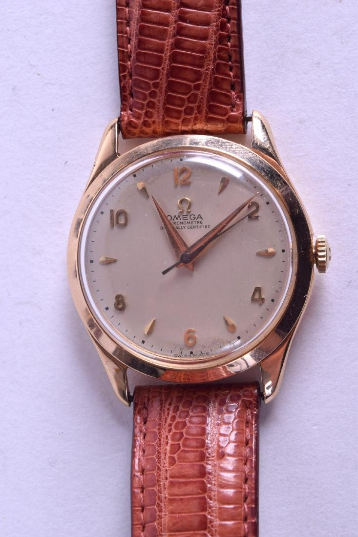 AN 18CT GOLD OMEGA CHRONOMETER WRISTWATCH with silvered