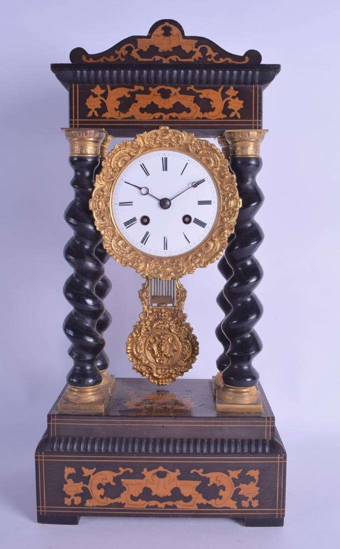 AN ANTIQUE CONTINENTAL CARVED WOOD PORTICO CLOCK inlaid