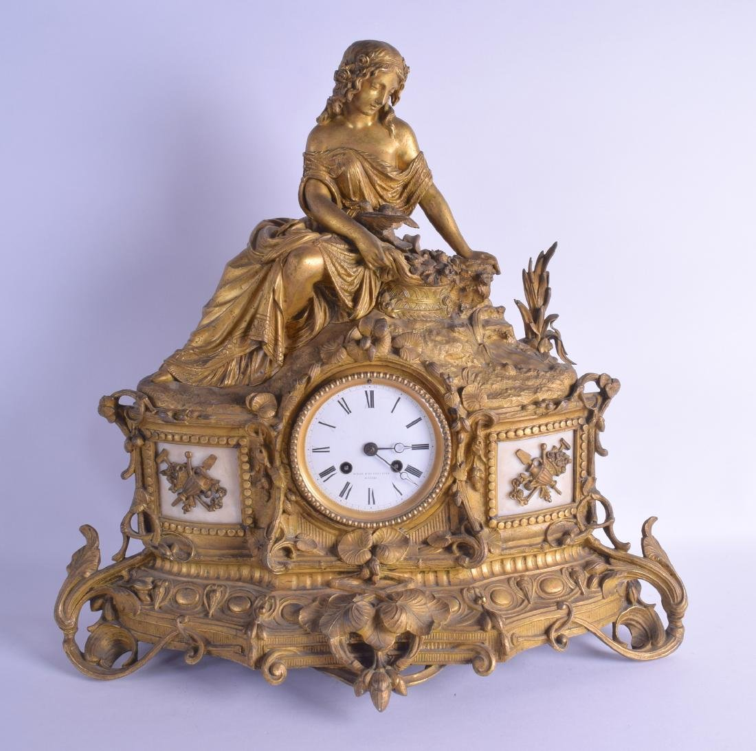 A LARGE 19TH CENTURY FRENCH GILT METAL MANTEL CLOCK