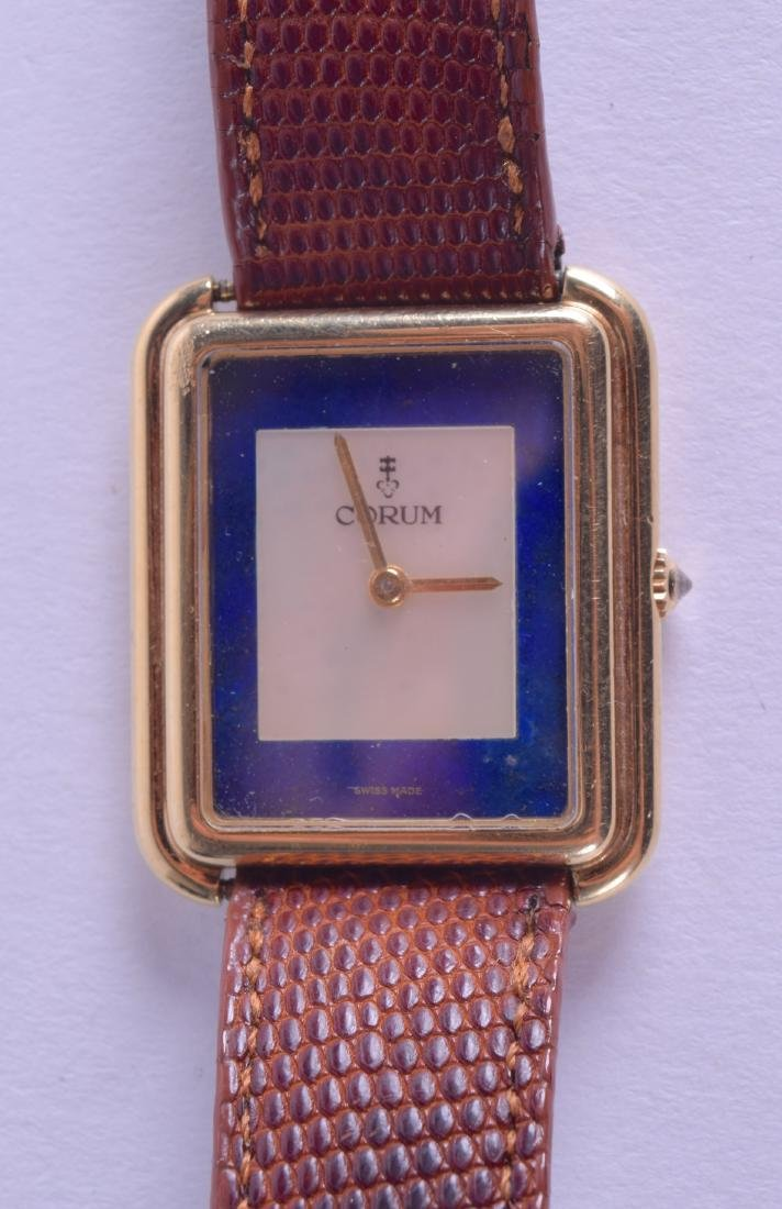 A STYLISH 18CT GOLD AND LAPIS LAZULI CORUM WRISTWATCH