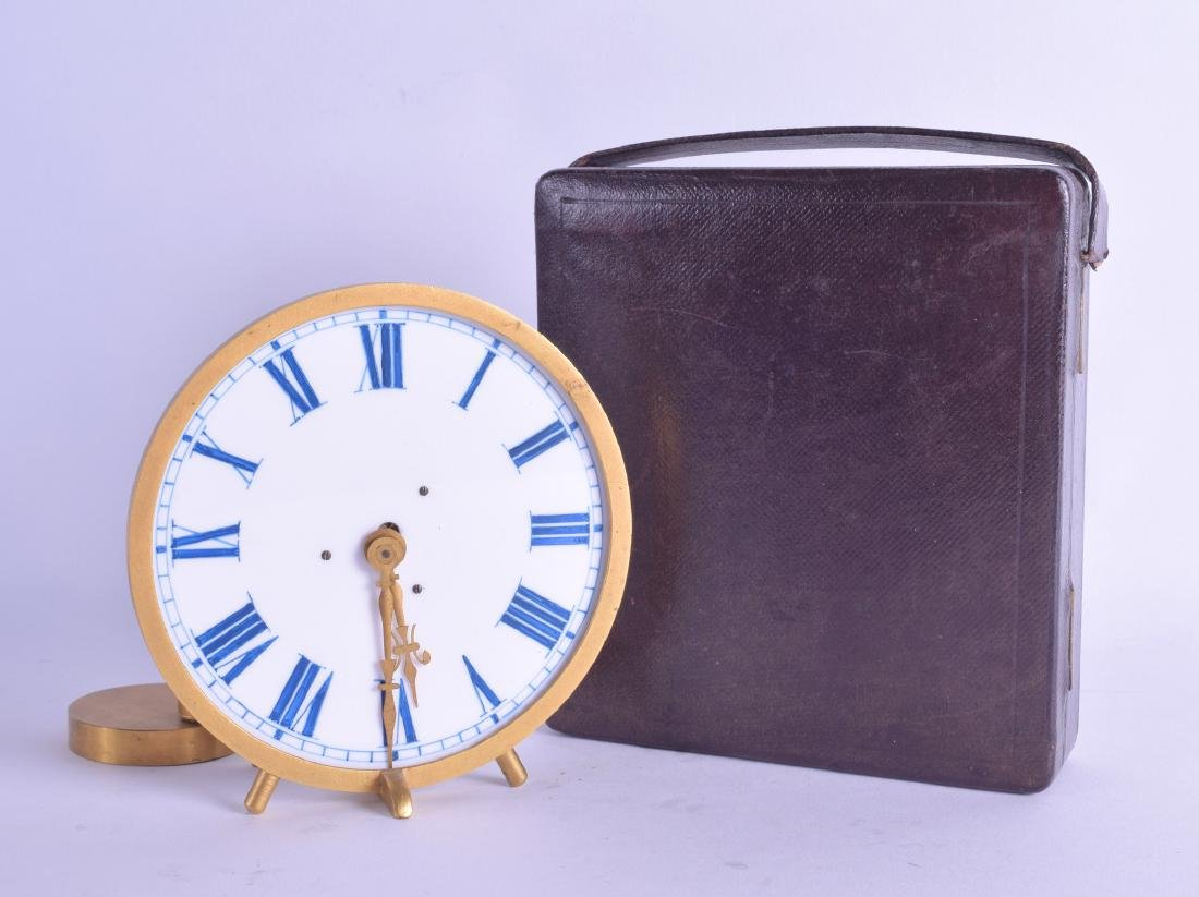 AN UNUSUAL ANTIQUE BOXED BRASS AND ENAMEL CANDLE CLOCK