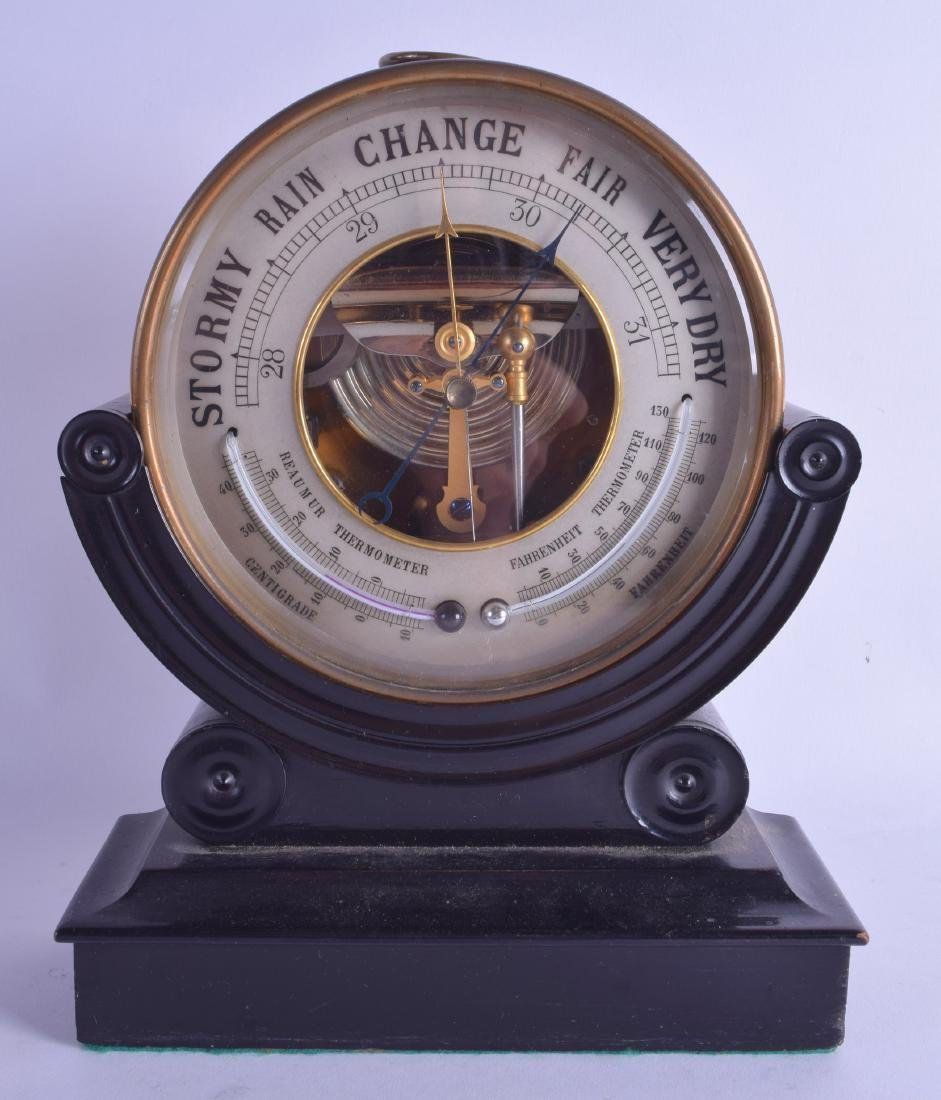 A STYLISH ANTIQUE BRASS OPEN WORK BAROMETER with