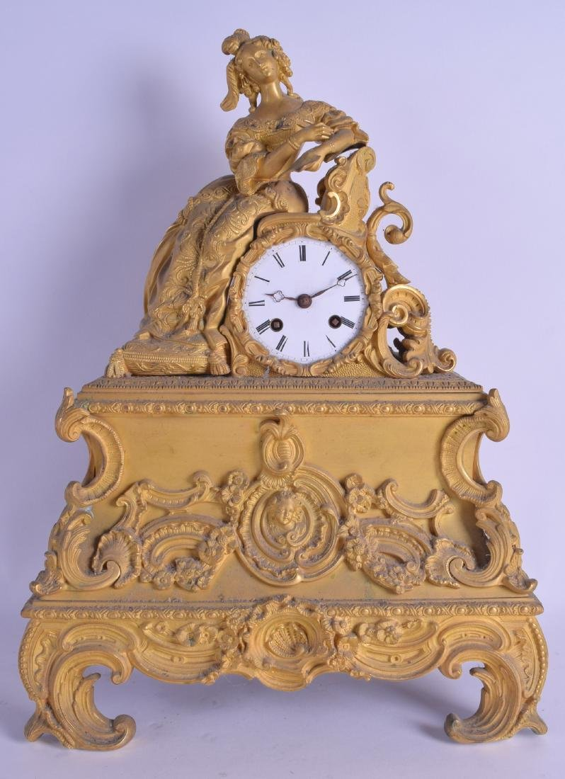A 19TH CENTURY FRENCH GILT METAL MANTEL CLOCK modelled