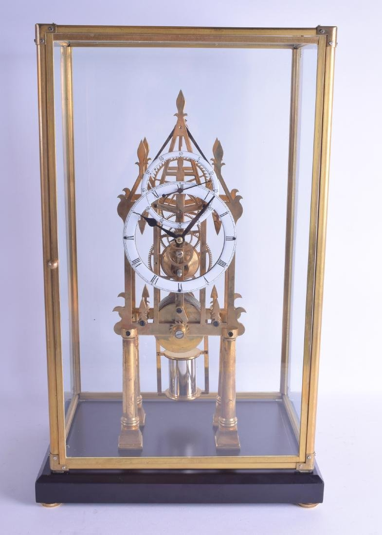 A CONTEMPORARY BRASS ARCHITECTURAL SKELETON CLOCK with