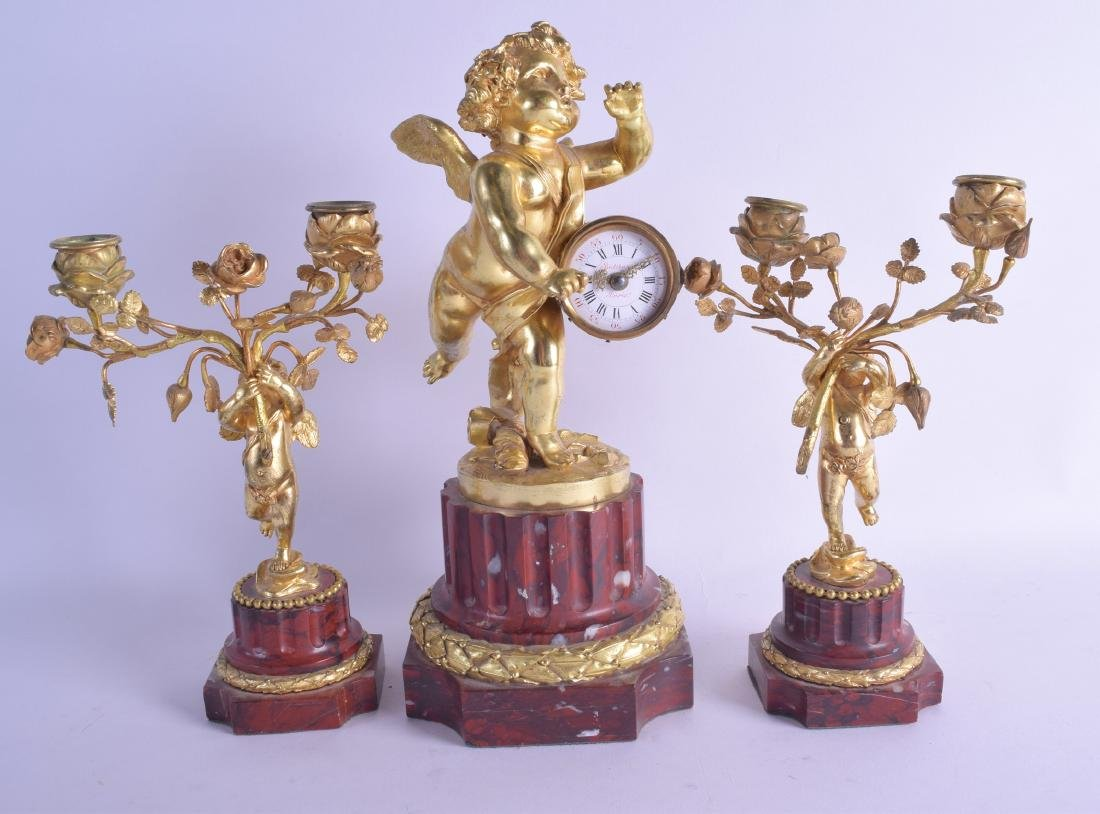 A GOOD EARLY 19TH CENTURY FRENCH GILT BRONZE AND MARBLE