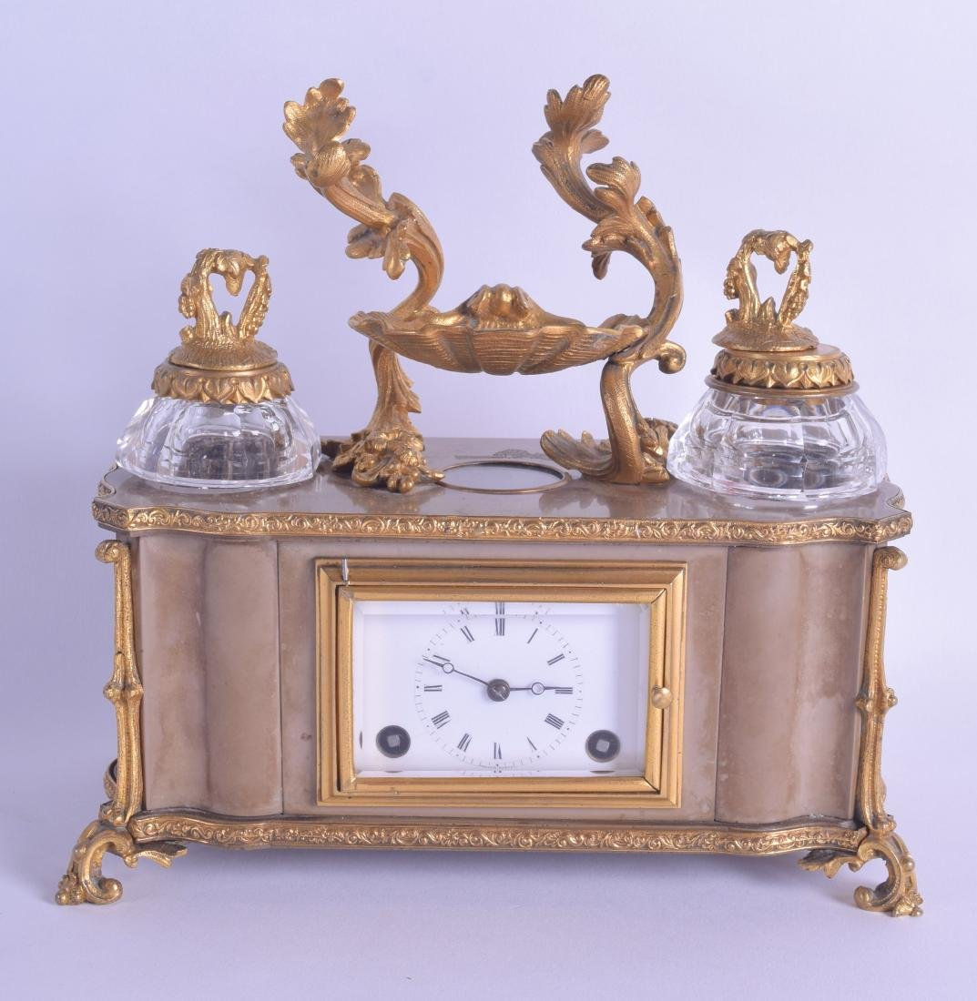 AN EARLY 19TH CENTURY FRENCH BRONZE AND ORMOLU INKWELL