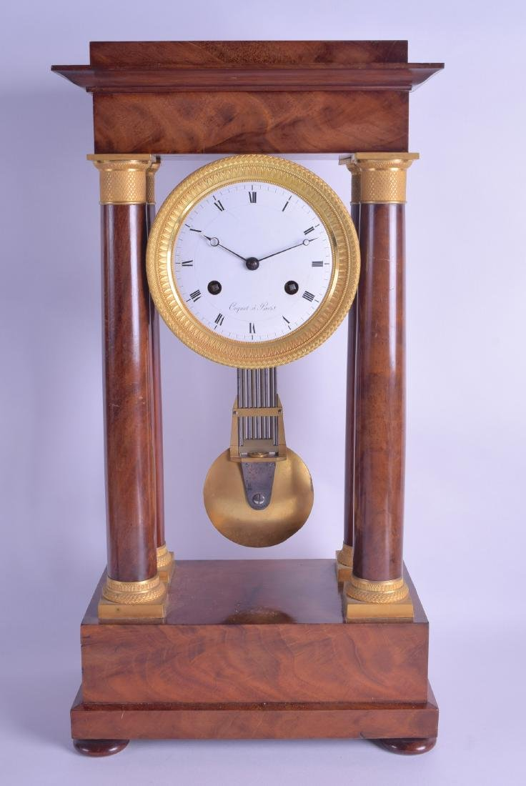 AN EARLY 19TH CENTURY FRENCH WALNUT EMPIRE MANTEL CLOCK