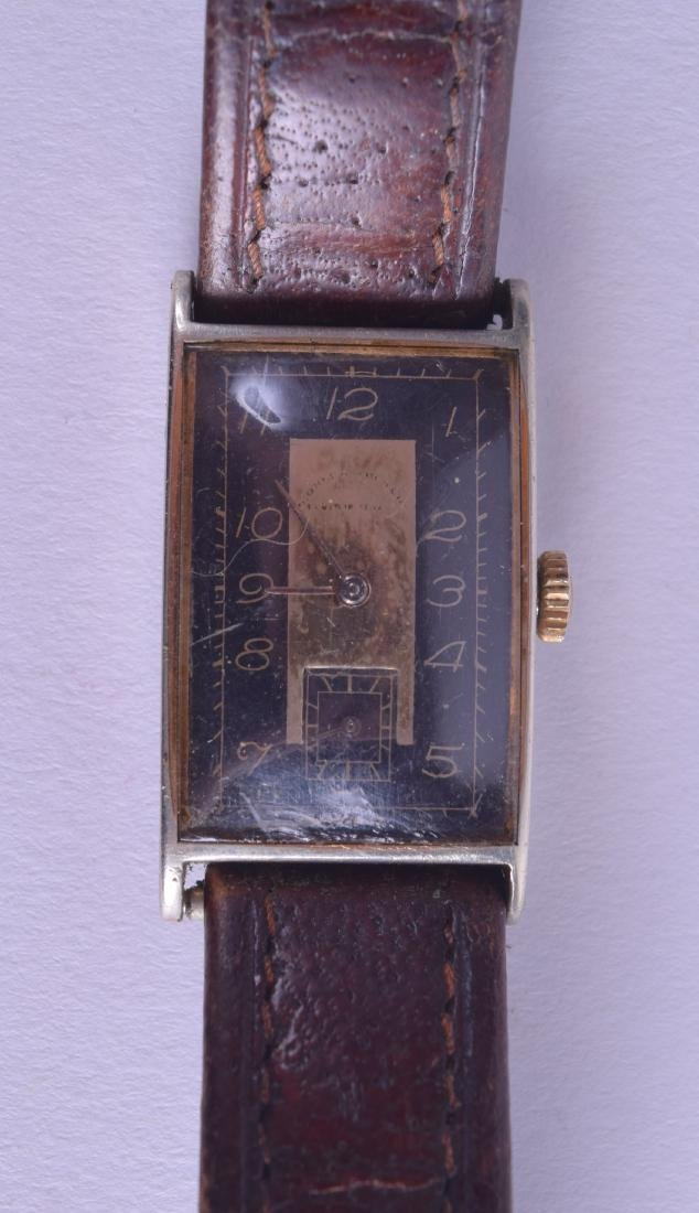 A 1930S GENTLEMANS YELLOW METAL AND STEEL WRISTWATCH