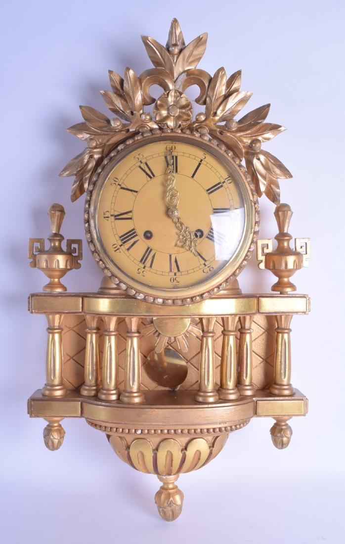 A CONTINENTAL GILT WOOD CARTEL CLOCK with column