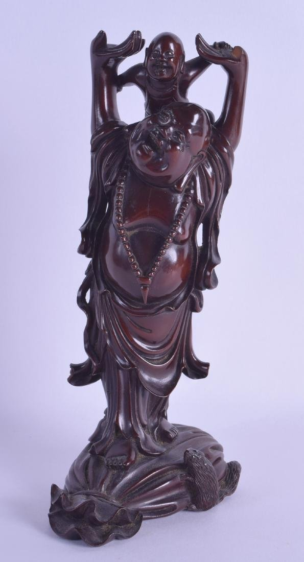 A LATE 19TH CENTURY CHINESE CARVED HARDWOOD FIGURE OF A