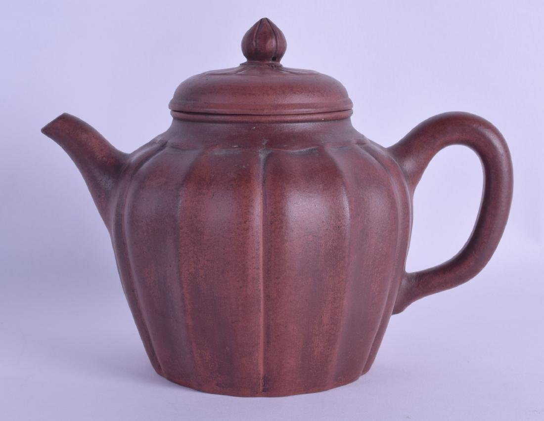 A CHINESE YIXING POTTERY TEAPOT AND COVER of lobed form