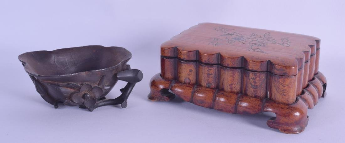 AN UNUSUAL CHINESE QING DYNASTY CARVED WOOD LIBATION