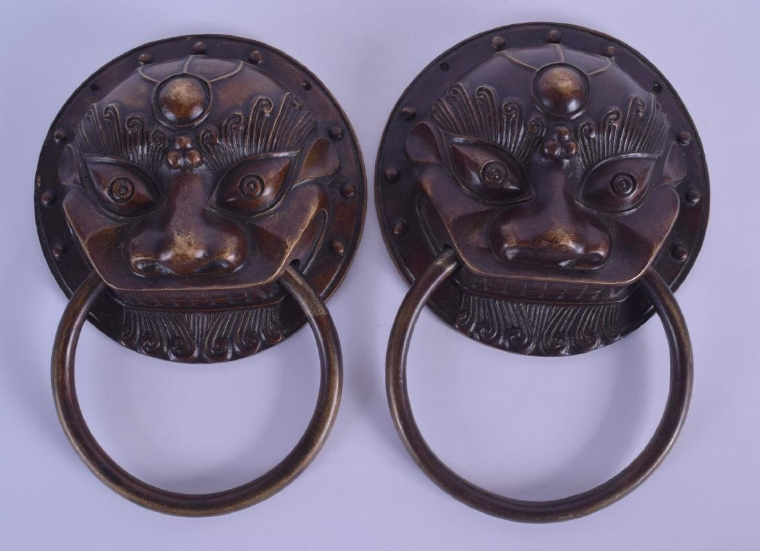 A RARE PAIR OF CHINESE QING DYNASTY BRONZE DOOR