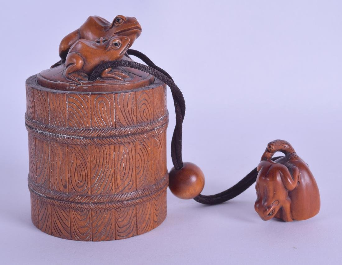 A LARGE JAPANESE CARVED BOXWOOD TOBACCO BOX AND COVER