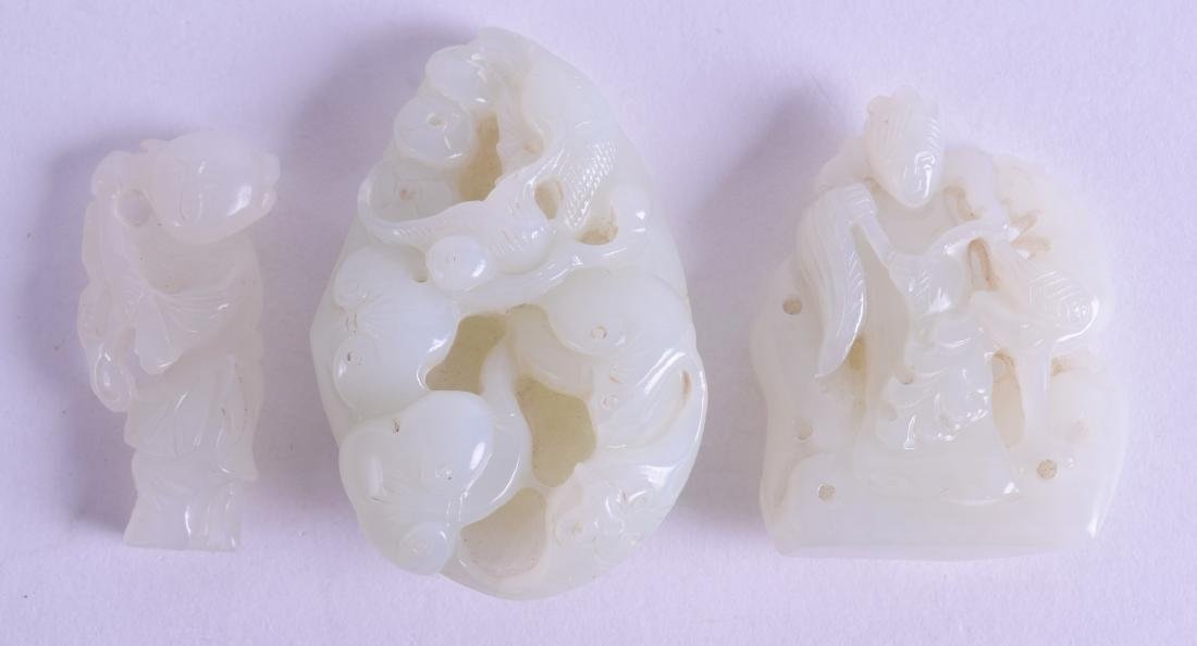A GROUP OF THREE CHINESE GREENISH WHITE JADE CARVINGS