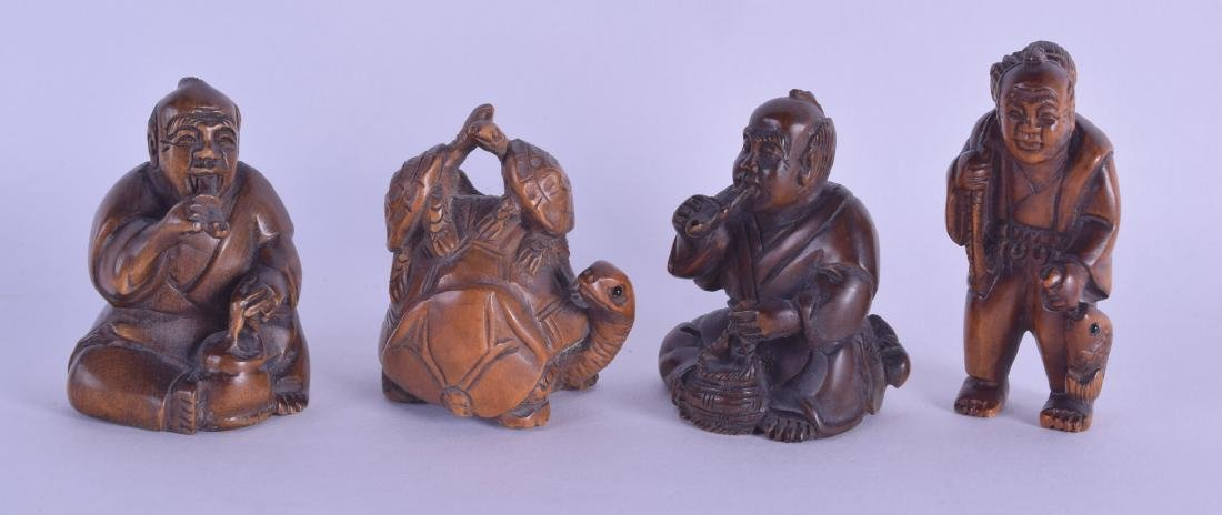 A GROUP OF FOUR JAPANESE CARVED BOXWOOD NETSUKES