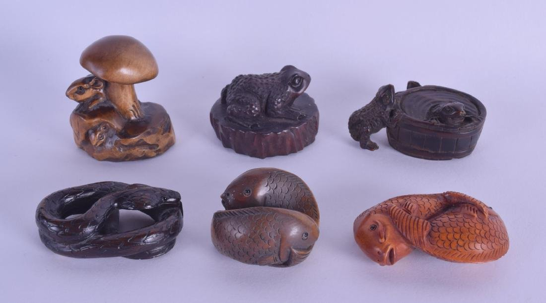 A GROUP SIX JAPANESE CARVED BOXWOOD NETSUKES in various