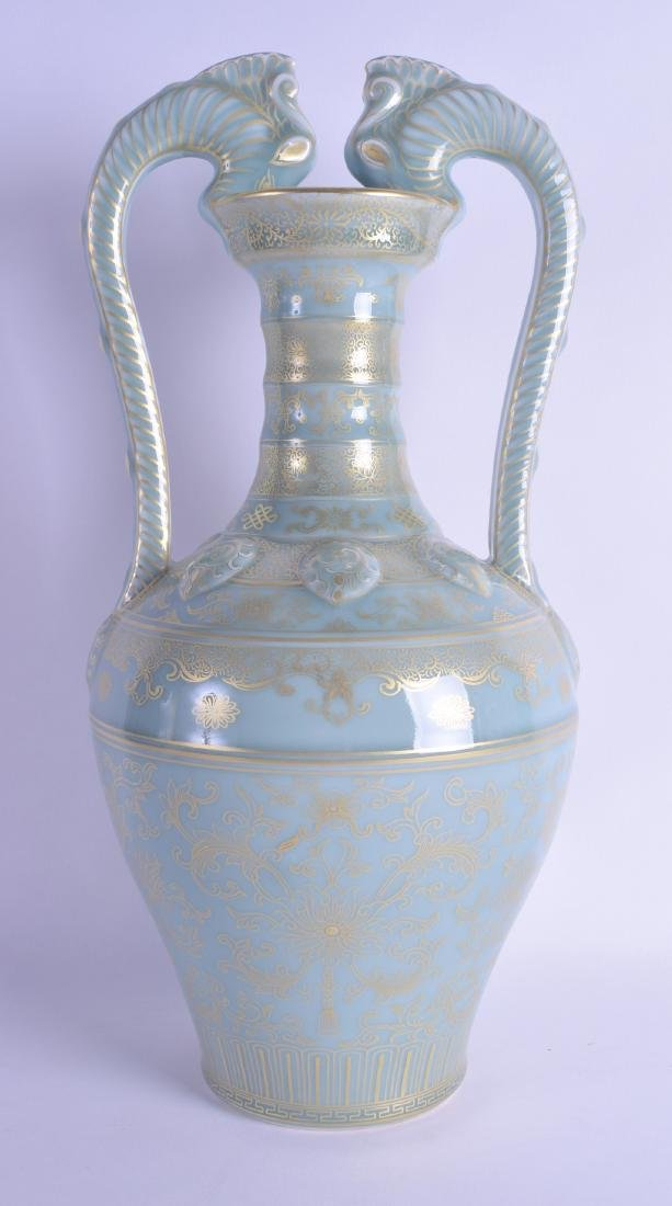A LARGE CHINESE TWIN HANDLED GILT PAINTED CELADON TYPE