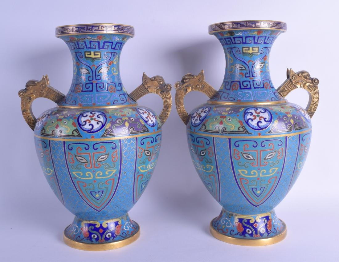 A PAIR OF 19TH CENTURY CHINESE TWIN HANDLED CLOISONNE