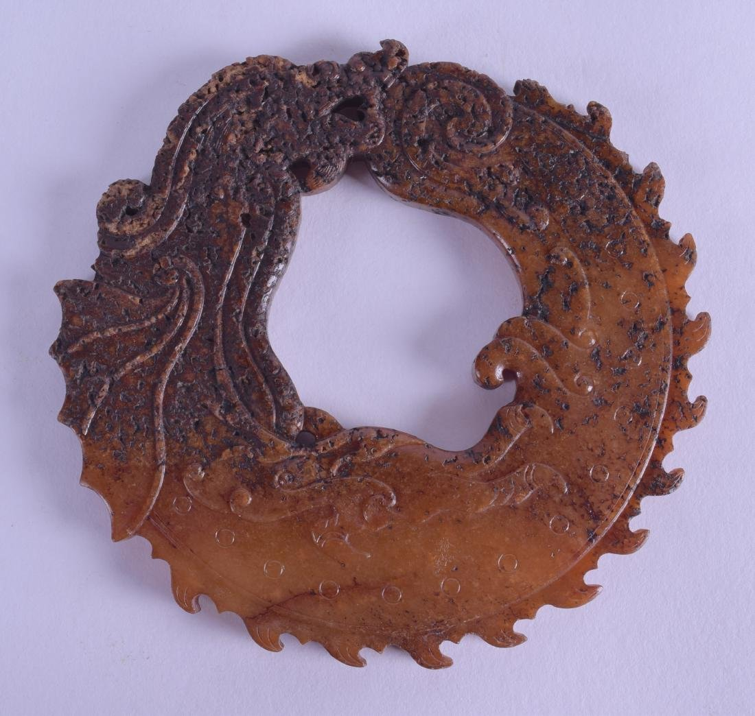 AN UNUSUAL CHINESE QING DYNASTY CARVED JADE BI DISC