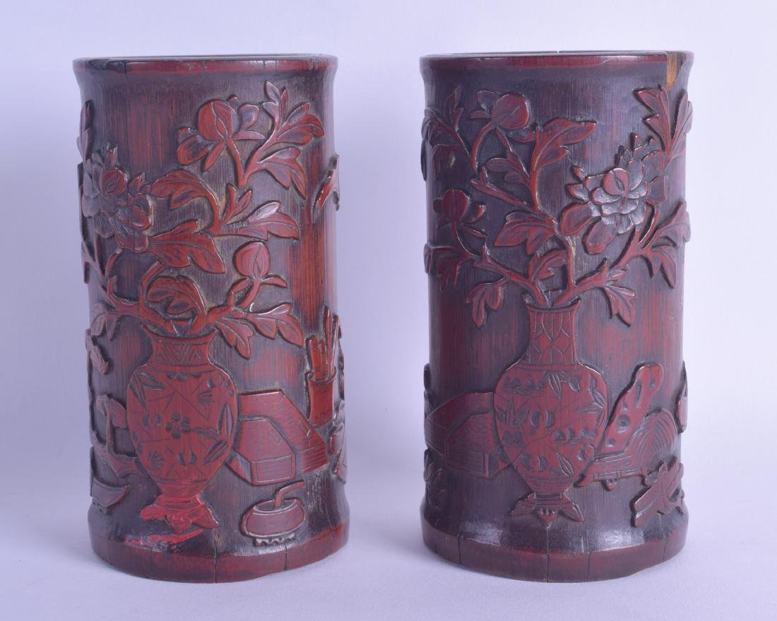 A PAIR OF CHINESE QING DYNASTY CARVED BAMBOO BRUSH POTS
