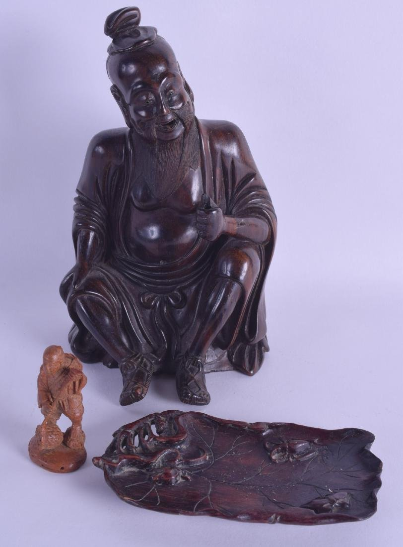 A 19TH CENTURY CHINESE CARVED HARDWOOD FIGURE OF A