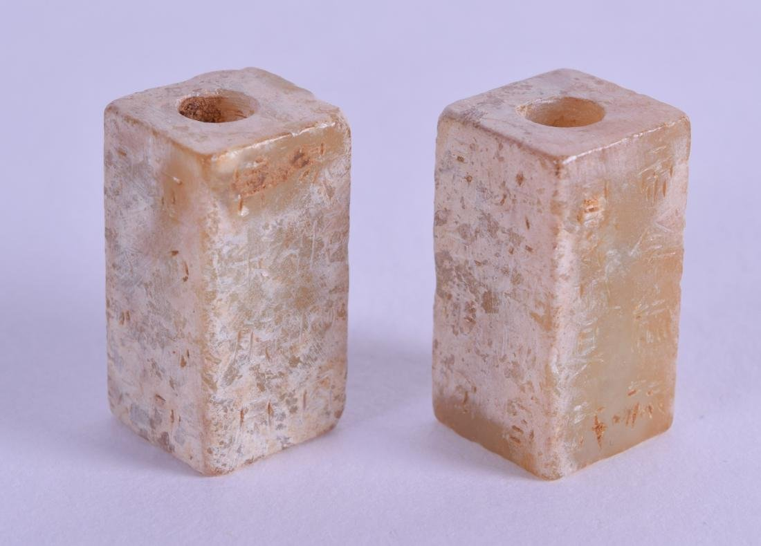 A PAIR OF MINIATURE GREEN JADE TOGGLES in the archaic