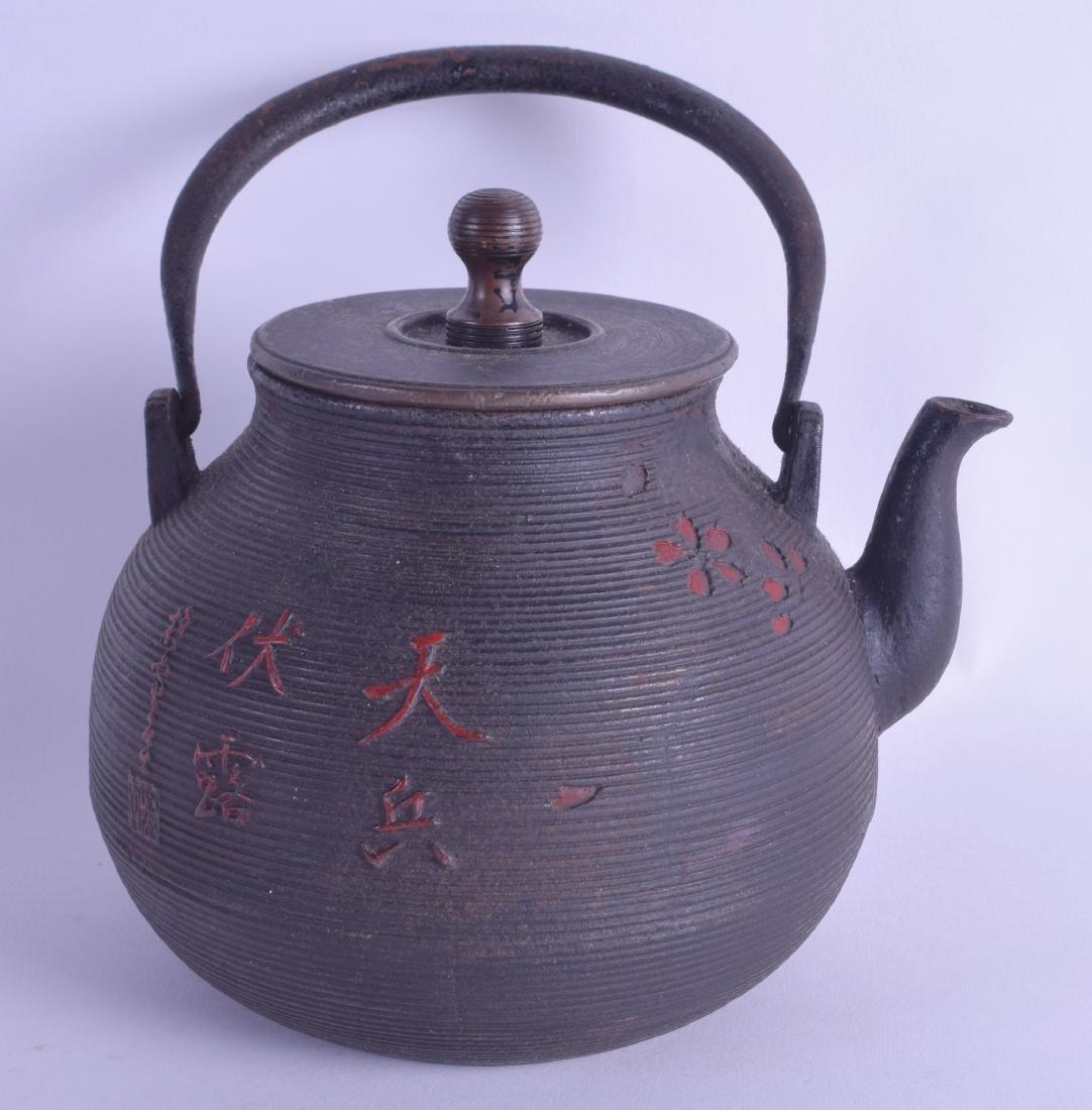 AN EARLY 19TH CENTURY JAPANESE CAST IRON EDO PERIOD
