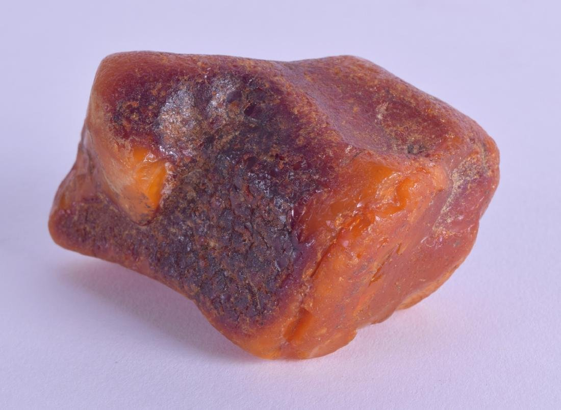 A RARE CHINESE QING DYNASTY CARVED AMBER SCHOLARS ROCK
