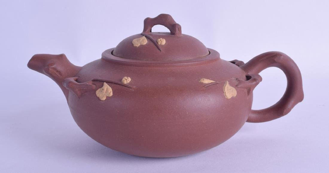 A CHINESE YIXING POTTERY TEAPOT AND COVER decorated