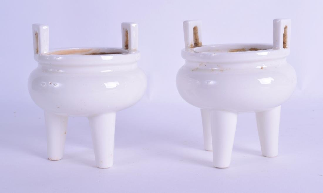 A PAIR OF CHINESE TWIN HANDLED BLANC DE CHINE CENSERS