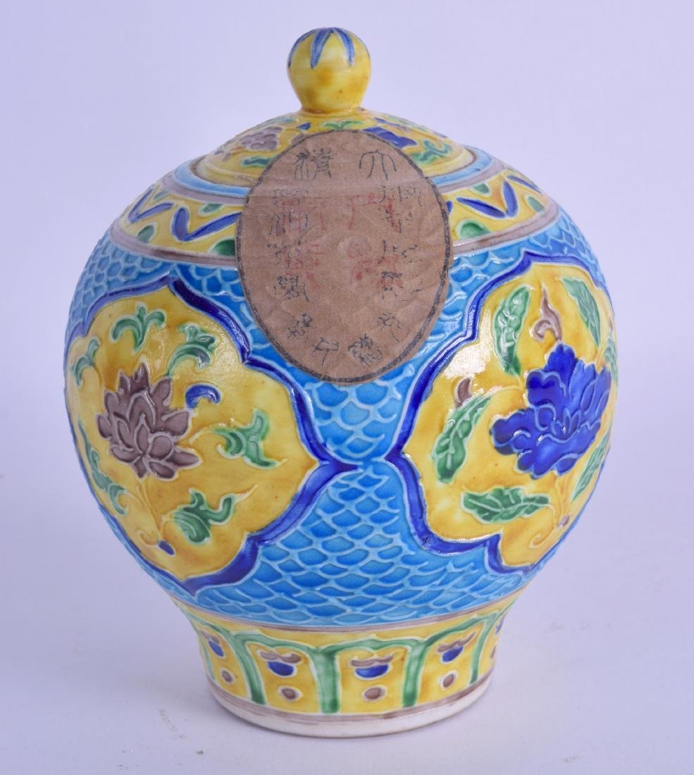 A CHINESE YELLOW GLAZED SANCAI JAR decorated with