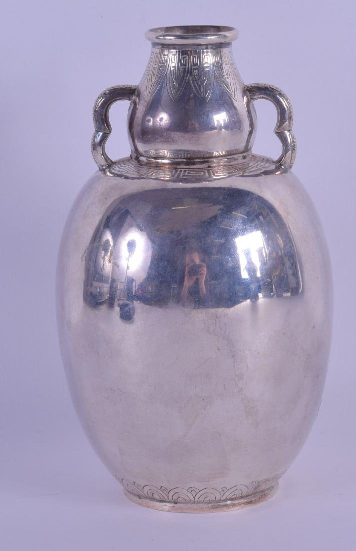 A LATE 19TH CENTURY CHINESE EXPORT TWIN HANDLED SILVER