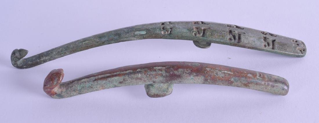 TWO EARLY CHINESE BRONZE BELT HOOKS probably Han