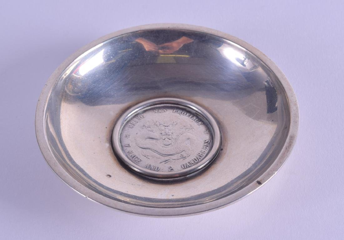 AN EARLY 20TH CENTURY CHINESE SILVER MOUNTED COIN