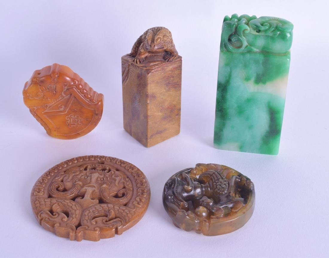 A CHINESE CARVED ORANGE HARDSTONE SEAL possibly