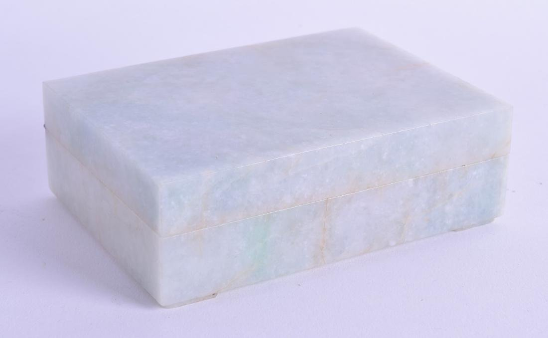 AN EARLY 20TH CENTURY CHINESE CARVED JADEITE CASKET AND
