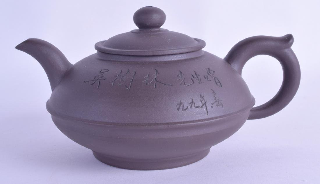 A CHINESE YIXING POTTERY TEAPOT AND COVER incised with