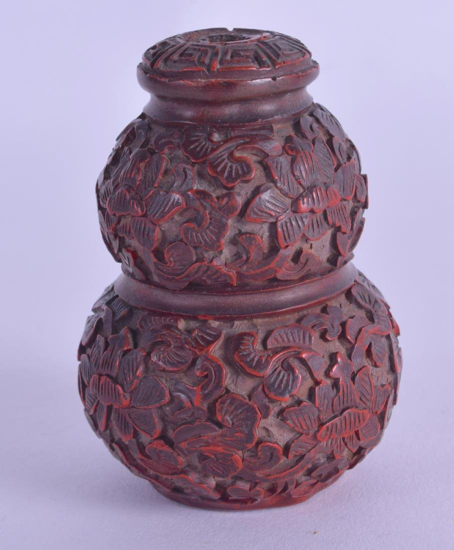 A CHINESE QING DYNASTY CINNABAR LACQUER SNUFF BOTTLE